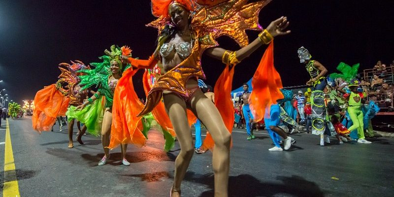Large group of dancers who, in a uniform manner, dance a rhythmic step in time with accompanying instruments entered the carnival scene: